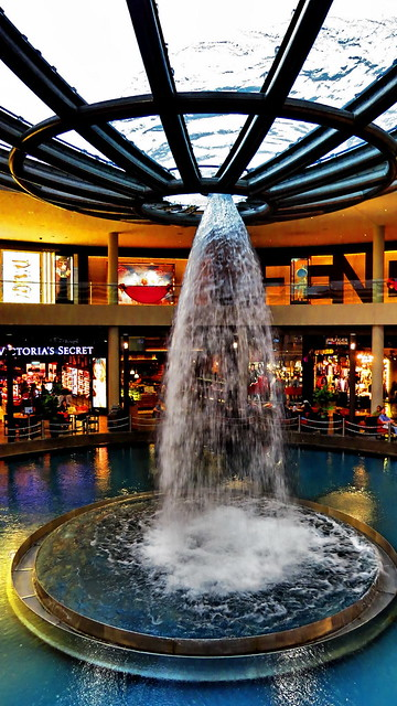 Under the fountain, in front of the Victoria's Secret.. well..