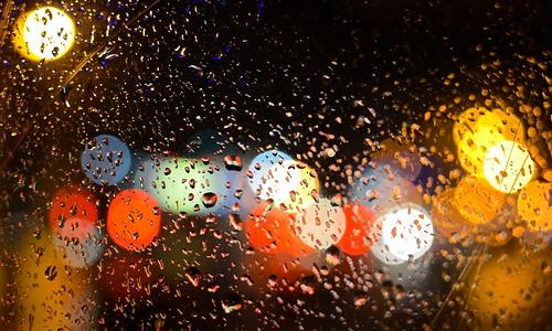 street columbus ohio bus window water glass rain night dark lights drops high focus gallery bokeh north stop rainy short raindrops hop multicolored