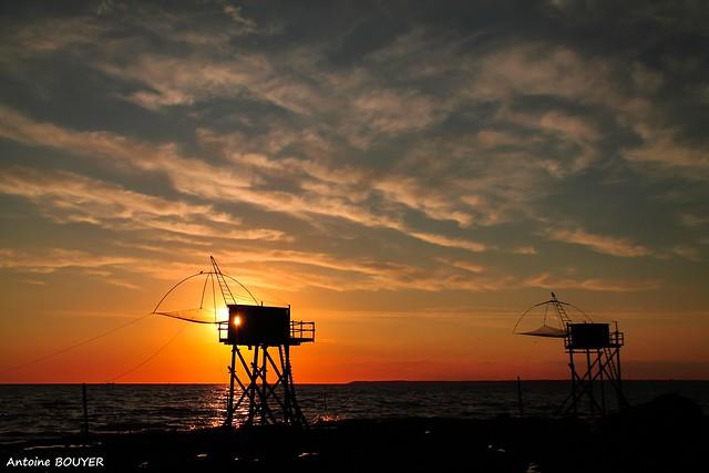 Pêcherie au soleil couchant