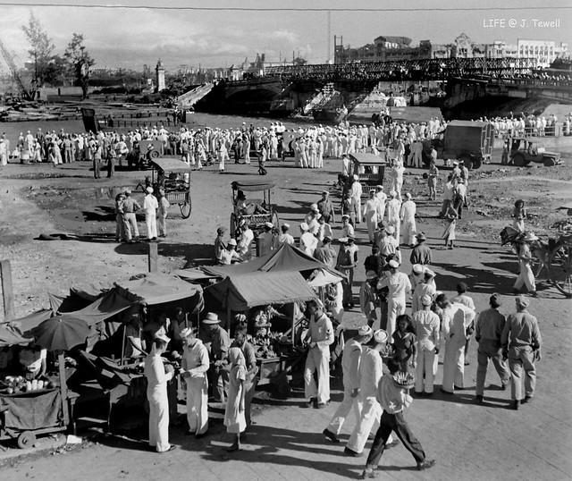 American sailors, Pasig River, Jones Bridge, Manila, Philippines, Sept. 1945