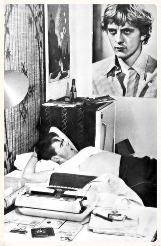Carleton University student greets another day in residence 1968. Poster in the background from 1960's cult movie Blow-up.