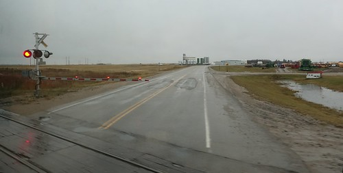 canada viarail railroad train thecanadian saskatchewan crossing gradecrossing road gate prairie lecanadien watrous