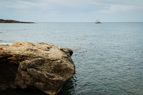 sea vacation beach rock horizontal turkey boat fishing rocks waves view recreation