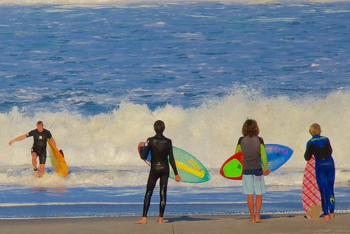 ocean beach surf surfer surfboard wetsuit