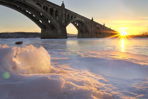 bridge winter sunset sky sun snow ice water river frozen columbia columbiapa veteransmemorialbridge