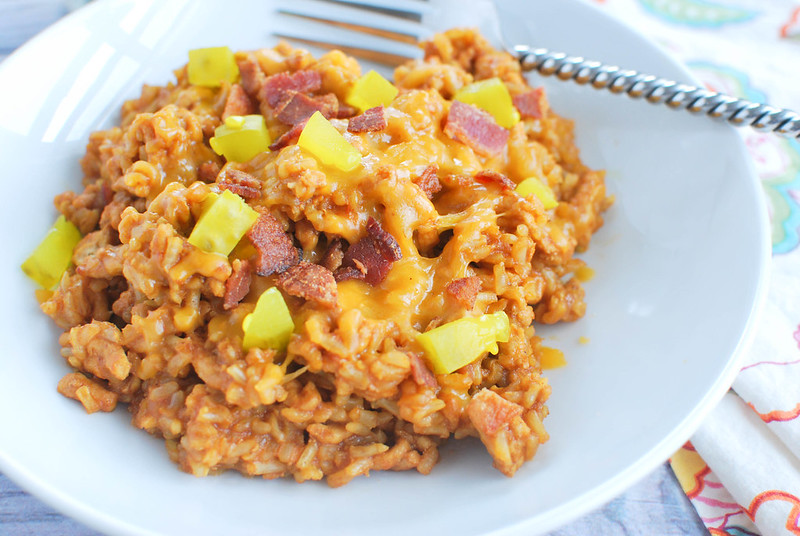 Bacon Cheeseburger Rice - delicious cheesy rice with ground beef, bacon, barbecue sauce, and pickles on top! It's ready in less than 20 minutes and a definite kid favorite!