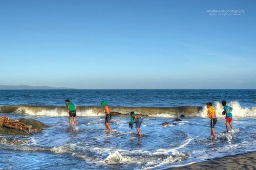 sunset sea beach kids children crossing estuarine