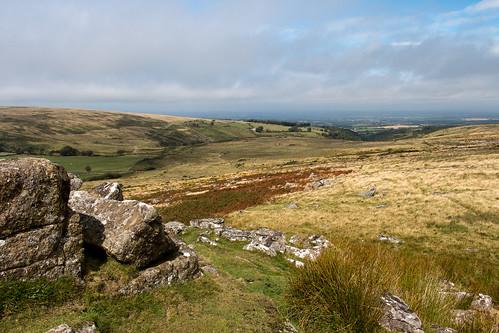 dartmoor nationalpark devon england moorland landscape hill granite rock outcrop tor wintertor grass bracken rushes clouds outdoor