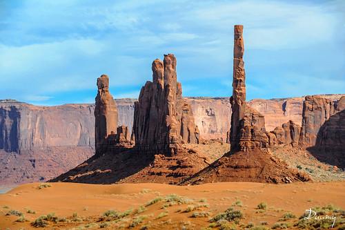 voyage arizona orange usa cloud monument rock soleil desert sable reserve totem erosion valley lumiere terre navajo nuage paysage kayenta indien rocher tourisme ocre herbe touristique fantastique étatsunis merveilleux ouest amerique decouvert farbwest