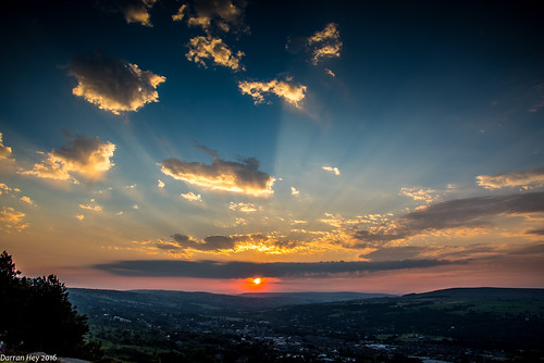sun dramatic skies colour amazing ray rays ilkley moor yorkshire uk view cloud beautiful serene tranquil formation light cowcalf cow calf tree valley town landscape fields