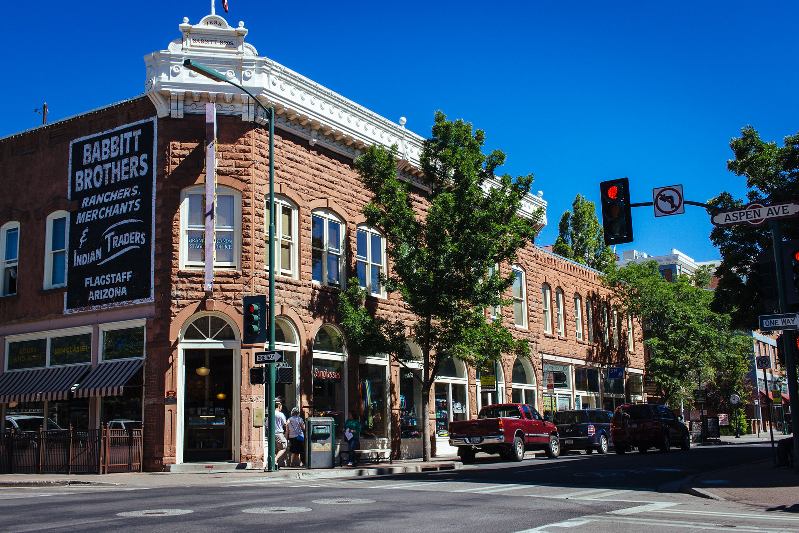 Historic stone storefront on a treelined downtown street in Flagstaff, Arizona