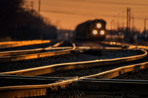 freighttrain locomotive headlights unionpacificrailroad uprr genevasubdivision sunset evening goldenhour dusk tracks rails patterns glow glowing westchicagoillinois diamonds crossing jbtower curves compression switches crossovers ballast fasteners april spring bokeh dupagecounty chicagoland transportation selectivefocus approaching oncoming order chaos intersection interchange junction canadiannationalrailway cn elginjolietandeasternrailway eje abstract abstrack nikond7500 sigma18300 photoshopbyfehlfarben thanksbinexo