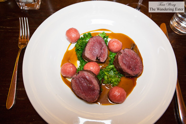 Roast venison loin from Middlewood Farm Breconshire, prosciutto beetroot and goat's cheese gnocchi, kale and creamed porcini mushroom jus