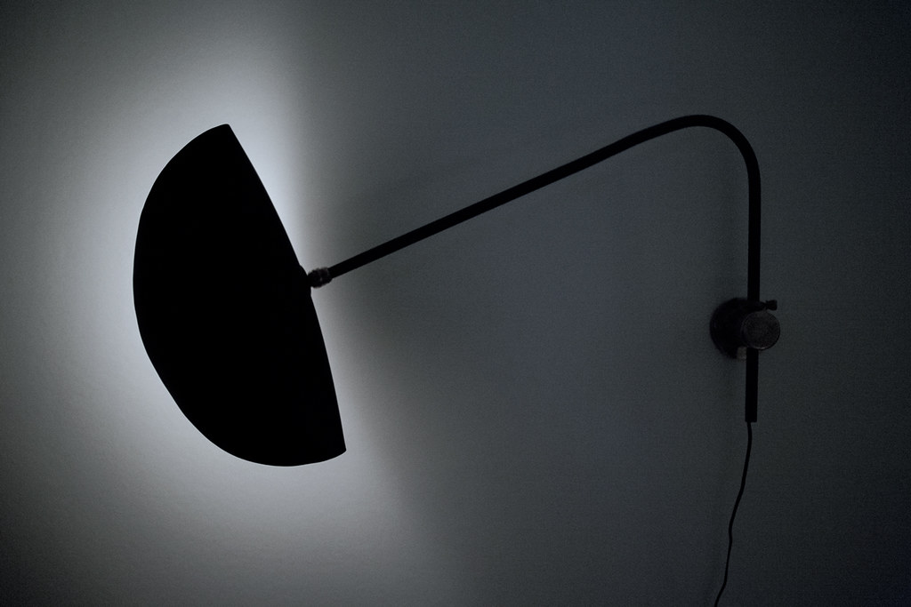 French wall lamp in the style of Serge Mouille.