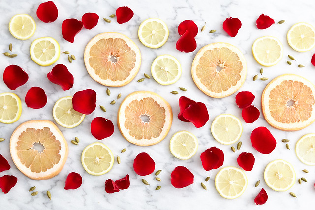 Grapefruit and lemon slices with rose flower petals