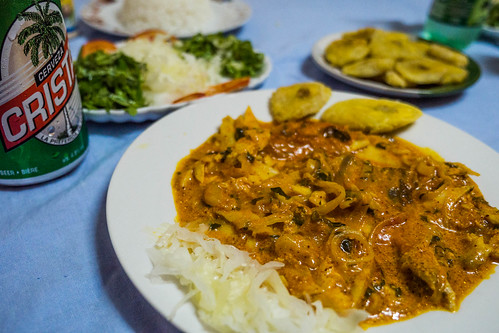 Fish in Coconut sauce dish with salad and banana chips and beer in Baracoa, Cuba.jpg | by crystalcastaway
