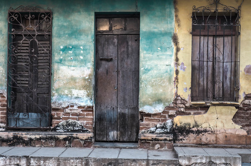 Blue and Yellow faded wall textures and old colonial buildings in Trinidad, Cuba.jpg   by crystalcastaway