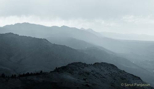 rain mountainrange hazy clouds windy evening public