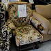 Dark wood stained fabric armchair