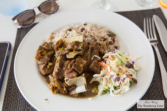 Curry goat with rice and peas and cole slaw