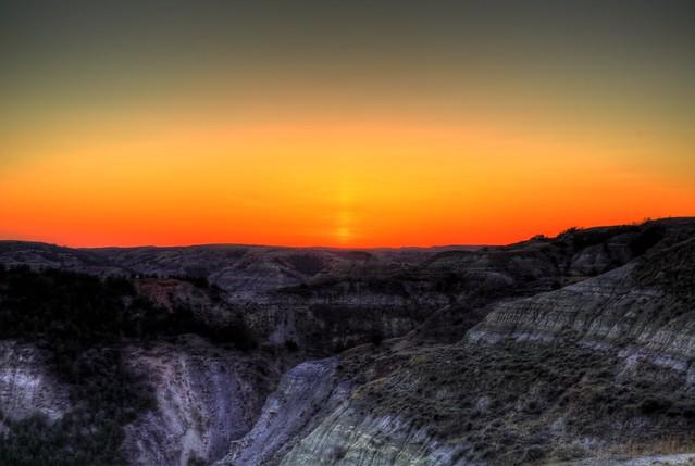 Sun drops over the horizon