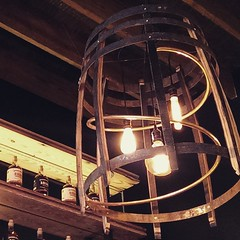 Lighting made from barrels & copper whiskey still piping