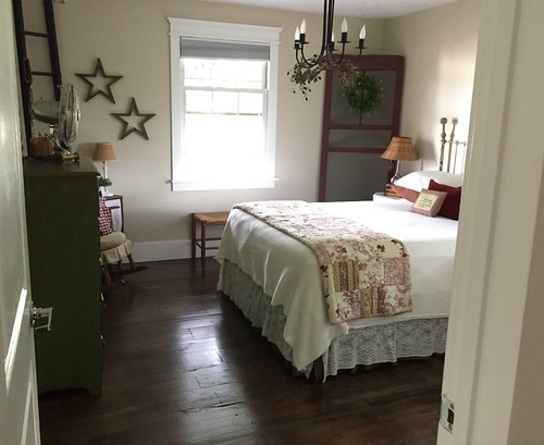 farmhouse bedroom with iron bed