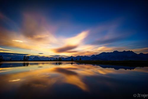 refelctions sunset see austria mutters lake alpen clouds muttereralm austrianalps alps fif bridge trojer jtrojercom tirol mountain