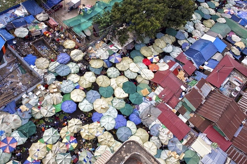 asia phnom penh from above city urban landscape view panorama market old umbrella beach roof top fish seller pedlar people customer street road beautiful asiasociety stunning amazing canon 6d canon6d tree cambodia garbage happyplanet asiafavorites