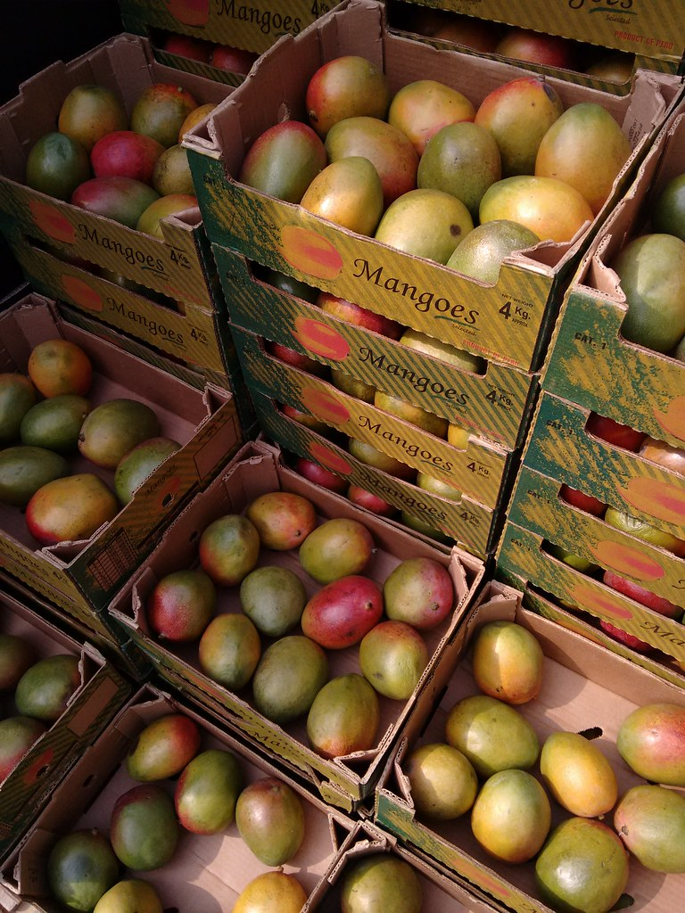 Mangoes in boxes. Credit: uncoolbob/Flickr