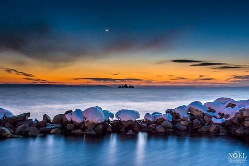 ocean winter sunset moon snow ice night newfoundland evening nikon rocks redsky newfoundlandandlabrador