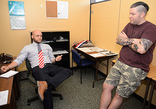 Tue, 06/21/2016 - 09:18 - Steven Fink talking with Christopher Nieves in GCC's Veterans Office