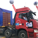 Truck_caravan_waving_IRU logo
