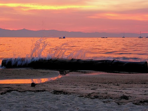 california sunset orange beach fire log sand waves smoke laketahoe alpine joelach