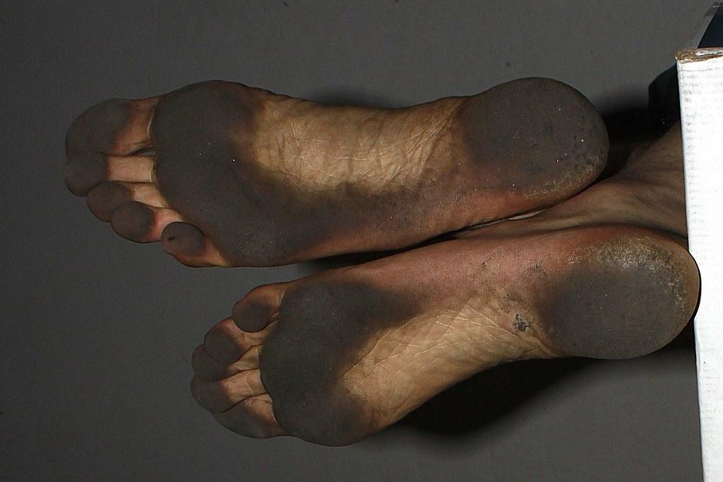 Boy barefoot dirty feet — Stock Photo   #138225310