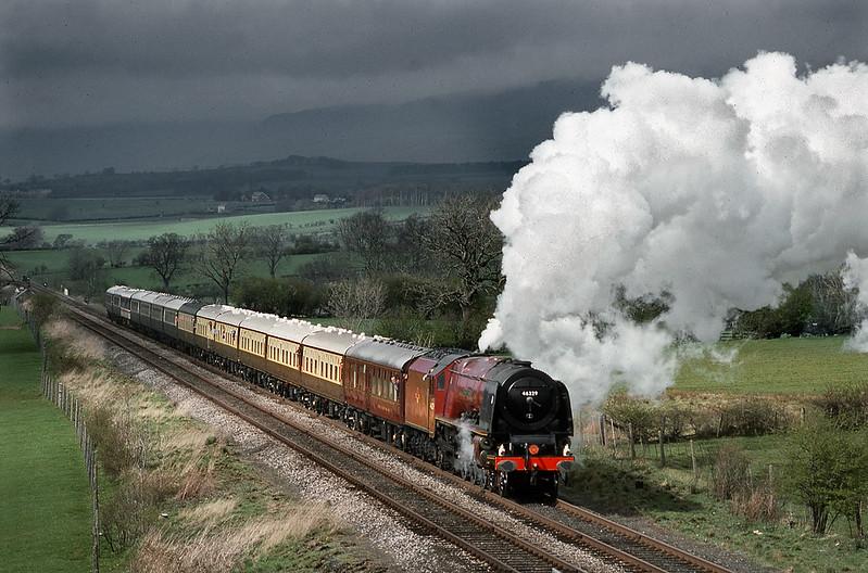 46229 Duchess of Hamilton nearing Appleby on return from Carlisle. 13 April 1990.