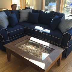 This sectional really adds a nautical feel to this fun lakehouse! #BellTower #BellTowerDesign #fourseasons #Gulllake #Indoorfurniture #sunbrella #slipcoveredfurniture