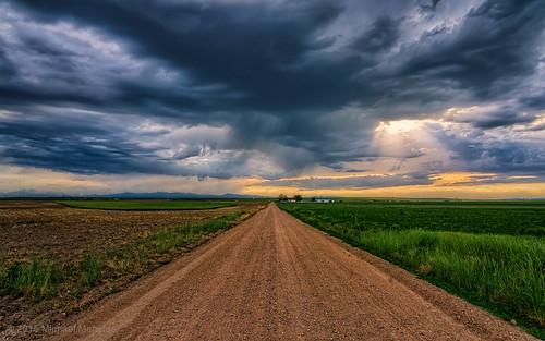 road sky clouds rural skyscape landscape vanishingpoint colorado weld farming dirtroad plains cloudscape menefee michaelmenefee