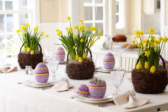 Easter baby chicks and daffodil baskets from ProFlowers with decorated painted Easter egg potted plants on a table with place settings