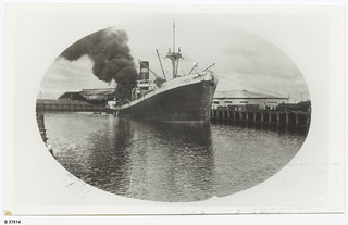 """""""City of Singapore"""" on fire at No.2 Dock, Port Adelaide. - Photograph courtesy of the State Library of South Australia"""