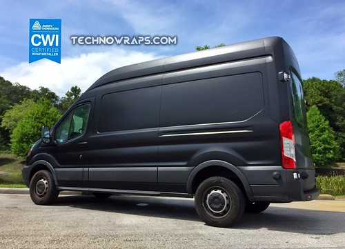 Satin Black vehicle wrap on Ford van in Orlando, Florida