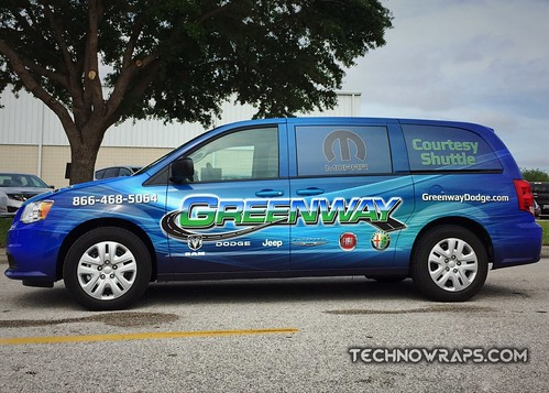 Dodge Caravan courtesy shuttle Van wrap in Orlando