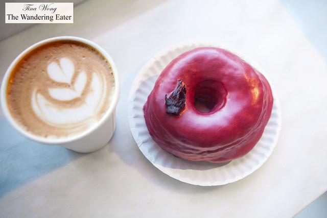 Hibiscus doughnut and cappuccino by Dough Doughnuts