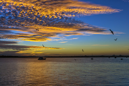 sunset sea sky water weather clouds boats sunsetsandsunrisesgold cloudsstormssunsetssunrises