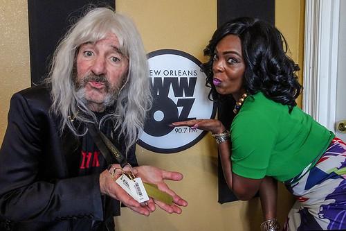 Derek Smalls shows off his WWOZ Brass Pass with WWOZ Membership Director KaTrina Griffin.