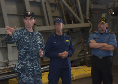 Cmdr. Michael Jarrett, commanding officer of USS Freedom (LCS 1), gives Vice Adm. Charles W. Ray, commander, U.S. Coast Guard Pacific and Royal Canadian Navy Rear Adm. William Truelove, commander, Maritime Forces Pacific a tour of the ship's waterborne mission zone as part of Three-Party Staff Talks. (U.S. Navy/MC3 Kory Alsberry)