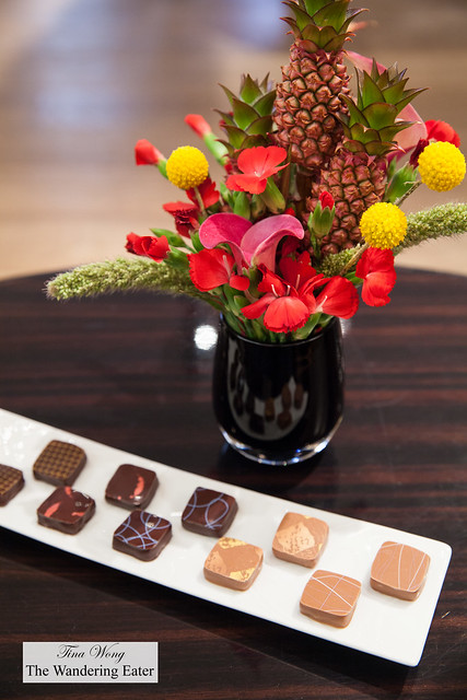 Our chocolates with a charming floral centerpiece with mini pineapples