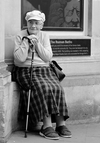 street old uk portrait england urban bw woman white black monochrome face hat photography prime mono nikon bath sitting candid 85mm somerset stick nikkor unposed 18g d7000 justard justardcom nikond7000nikkor85mm18gnikkor85mmf18gprimeprimelensstreetphotographystreetphotographycandidunposedurbanblackwhitemonomonochromebwbathsomersetenglandukjustardjustardfaceportrait