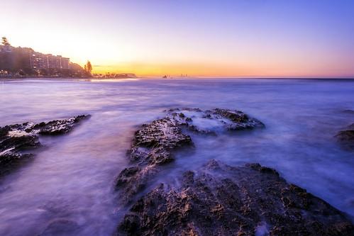 sunset sea water rocks sunsetsandsunrisesgold slowshutteronwater