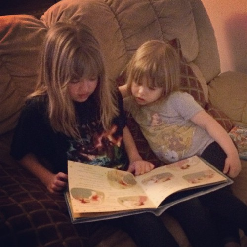 I don't think I'll ever get tired of watching Catie read to Lucy. | by poobou
